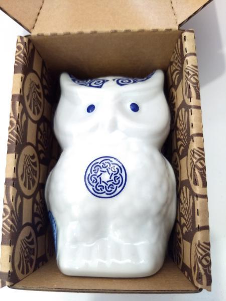 Búho de porcelana